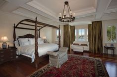 Traditional Master Bedroom with Chandelier, Box ceiling, Hardwood floors, High ceiling, Crown molding, Carpet