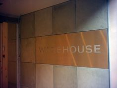 Polished concrete wall panels with the salon name on it- Paul Davies Design