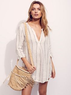 Linen Swing Dress | Lightweight and sheer linen swing dress featuring striped detailing with a rounded high low hem. V-neckline with three-quarter length sleeves. American made. Pair this style with one of our Signature Seamless styles.
