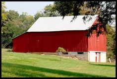 Red barn, white roof