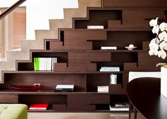 Modern Dark Wood Shelves - Sleek drawers below the stairs make a statement and  offer room to display favorite items