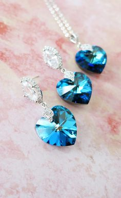 Items similar to Shakina - Bermuda Blue Swarovski Heart Crystal Earrings, Deluxe Cubic Zirconia Halo style Navette Teardrop dangle bridal blue Personalised on Etsy