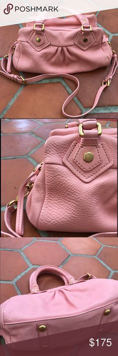 """Q Groovee"" Marc by Marc Jacobs hand bag in blush This blush pink ""q Groovee"" Marc by Marc Jacobs handbag has a double top handle or cross body strap. The inside has the signature lining, a zipper pocket and 2 cellphone type pockets. Measures about 12"" x 6"" in great condition with the exception of a small bit of clear nail polish on the bottom interior of the bag. Marc by Marc Jacobs Bags Crossbody Bags"