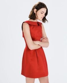 Stand out in a stunning red holiday dress.