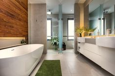 Accent timber wall adds warmth to the bathroom - Residence @ West Coast Way