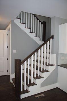 Bon Stairs   2 White Spindles On Each Dark Wood Tread. Dark Wood Railing. White