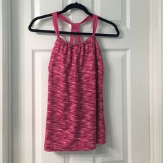 DANSKIN ATHLETIC TOP NEW WITHOUT TAGS. NEVER WORN. DANSKIN WOMENS ATHLETIC TOP. SIZE MEDIUM. SOFT & STRETCHY MATERIAL. PINK COLOR DESIGN. BUILT-IN SPORTS BRA. SCRUNCHED DETAIL ON FRONT SIDE. Danskin Tops Tank Tops