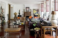 Fashion designer Michel Klein's well-collected Parisian home is a bounty of vintage furniture and framed artwork.