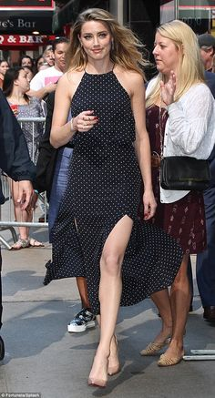 Polka-dot beauty: Amber Heard was spotted in New York City's Times Square on Monday as she headed to Good Morning America