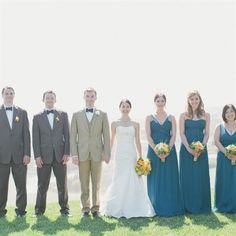 Each girl chose her own style of dress in the same deep-teal shade. The guys matched in dark-gray suit