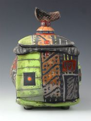 """Daniel Oliver Ceramics, Urn Series - """"I hand build my work. It gives me freedom to create my pieces. I begin with a slab or extruded piece of clay, add textures on the surface then shape my forms until I am pleased with what I see. I mostly do Raku firing which gives my work an earthy look. I brush, stamp or trail glaze my designs.""""  Pot Belly Box series"""