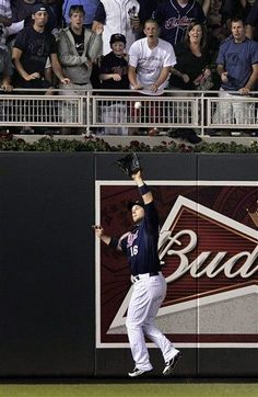 Minnesota Twins' Josh Willingham (16) jumps to catch a fly ball by Cleveland Indians' Jose Lopez in the eighth inning of a baseball game on Friday, July 27, 2012, in Minneapolis