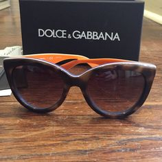 Dolce & Gabbana Cat Eye Sunglasses Like new Dolce & Gabbana sunglasses. Front of frames is tortoise shell and then the sides are red, white and blue stripes. Arms are tortoise shell, white and orange. 100% AUTHENTIC and purchased last summer at Sunglasses Hut. Comes with all original packaging including authentication papers, the outer box, red velvet hard case, dusting cloth/soft protective case. Very slight scratch on the left lens but does not effect wear at all! Dolce & Gabbana…
