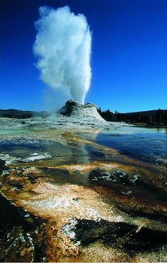 A geyser at Yellowstone National Park - Ride the train and visit Yellowstone on one of our fabulous vacations by rail.