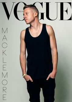 Mackelmore is sleek in a simple black tank top, long necklace and carefully combed hair.