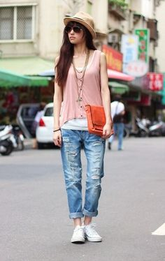 pink blouse, ripped jeans