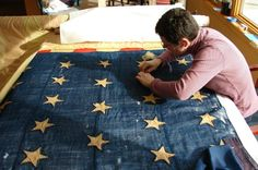 Conservator works on the museum's 34-star U.S. flag.