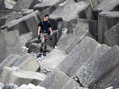 A police officer from Saint-Benoit's gendarmerie looks for debris from ill-fated Malaysia Airlines Flight MH370 on a beach in Sainte-Marie de la Reunion, on the French Reunion Island in the Indian Ocean. France launched a hunt for more wreckage from the plane Aug. 7 in a fresh effort to shed light on one of aviation's biggest mysteries.   Richard Bouhet, AFP/Getty Images