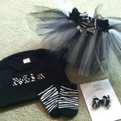 Blk and zebra tutu set. $32.00 sz 0-3 months. Matching socks, small Hairbow, tutu and  onesie with name on it by Veronica Arreola.