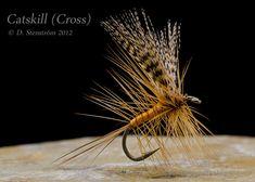 Catskill Cross   Wing: Wood duck flank, divided Tail: Dark to medium ginger hackle barbs   Body: Orange floss palmered with ginger hackle Hackle: Dark to medium ginger