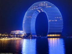 Sheraton Huzhou Hot Spring Resort: China unveils hotel shaped like a giant, glowing doughnut, this August.