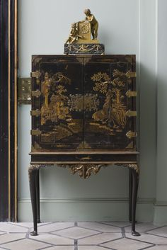 French gilt-bronze clock with putti on a lacquer cabinet in the Black and White Hall at Mount Stewart House, Co. Down, Northern Ireland.