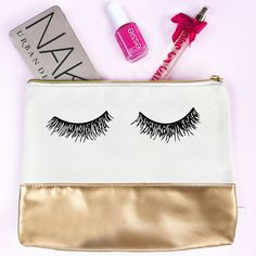 We love this cute makeup bag for our beauty essentials! Makeup bag| cosmetic | travel |bridesmaid gift | canvas bag | gift for her | gold leather | eyelashes | brush holder | organizer | storage | make-up | nail polish | lashes | cosmetic pouch