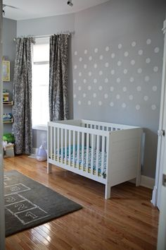 An adorable nursery that's gender-neutral, fun, and has a lot of fun details and pops of color!