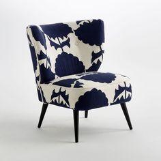 Le fauteuil Franck. Dossier galbé et assise confortable.   Caractéristiques : - Revêtement 100 % coton, broderies motif fleurs. - Structure en manguier massif et tube d'acier. - Suspension par ressorts et sangles. - Pieds manguier massif teintés noir et vernis nitrocellulosique.    Dimensions : - L.63 x H.74 x P.72 cm.- Assise : L.52 x H.42 x P.45 cm.
