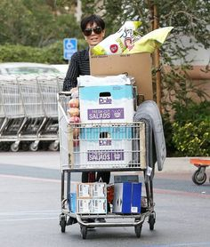Kris Jenner groceries sunglasses stripes boots large groceries reality kardashian