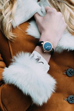 We love it when form meets function and Gucci's gold-trimmed leather watch is a shining example. Treat yourself to this timeless timepiece and wear to give a casual winter knit easy elegance.