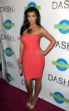I love this coral dress kim is wearing even though she doesnt look the best