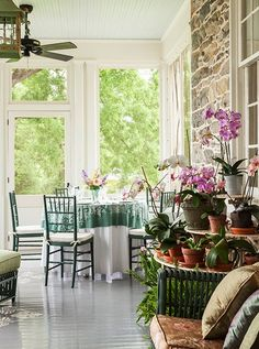 Elizabeth loves to set up meals on the orchid-covered enclosed porch.