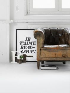 Yum! the patina of this chair combined with the sleek letters, framed in black
