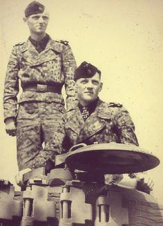 Panzerwaffen crew on their Panzer's turret.