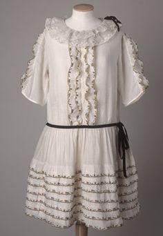 Young girl's embroidered white cotton lawn party dress with double-frilled net collar, c. 1920-25.