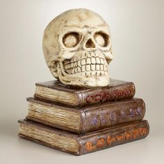 Skull on Books Decor at Cost Plus World Market - Decorate your home in bone-chilling style with this frightfully fun Halloween must-have >> #WorldMarket Halloween #HalloweenDecor #HalloweenEntertaining