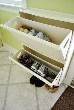 Use recycling bins from Ikea to store shoes in an entryway. | 33 Ingenious Ways To Store Your Shoes