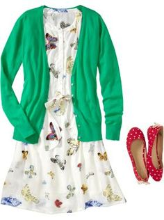 love this with the red shoes! the blue version of this dress is even cuter! (but no green sweater- what's up with that?)