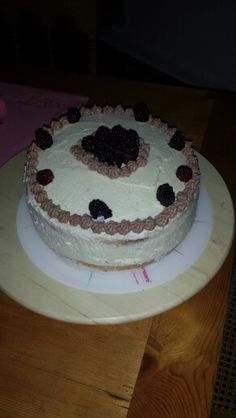 Cake with mixed berries chocolate pudding and cream. Made out my 3 rest pieces of bisquit.