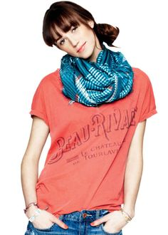 A bundled scarf in a contrasting color gives a T-shirt style cred—and keeps your neck cozy.