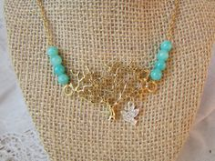 Hey, I found this really awesome Etsy listing at https://www.etsy.com/listing/222067136/handmade-silver-bird-gold-tree-necklace