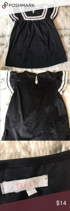Tulle Retro Ruffle Trim Square Neck Vintage Top Tulle flair silky black top with ruffle sleeve and lace ribbon embellishments. Note the last picture shows a very small snag under the tag, to the back of the shirt. Only noticeable up close. Tulle Tops Blouses