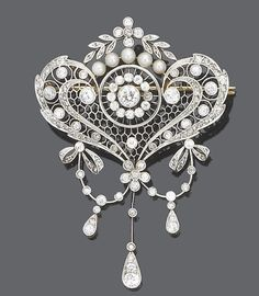 A belle époque diamond and pearl brooch/pendant, circa 1905  Of ribbon bow and garland design, the pierced pendant of honeycomb design with pierced cartouche and scroll surround to a foliate surmount set throughout with old brilliant, single and rose-cut diamonds, suspending a flexible triple tassel drop with ribbon bow and garland surmount, old brilliant and single-cut diamonds approx. 2.40ct. total, length 6.0cm., fitted case