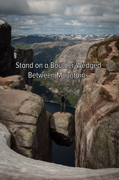 Bucket list: brave the heights by standing on a boulder wedged between mountains!