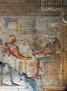 Seti I, dressed as a priest next to the offering table in front of Horus, behind them Isis and Osiris. Temple of Seti I at Abydos.