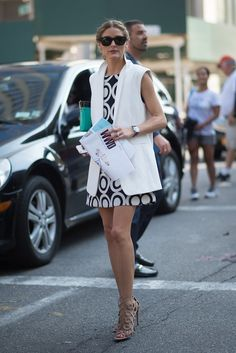 Update your shift dresses with an outfit-making vest, a la Olivia Palermo. Image Source: Getty / Timur Emek