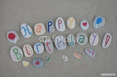 "Download the royalty-free photo ""Happy Birthday on carved stone letters over the sand "" created by Ciaobucarest at the lowest price on Fotolia.com. Browse our cheap image bank online to find the perfect stock photo for your marketing projects!"
