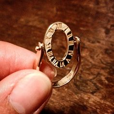 Interesting little spinning face ring with Roman numerals in 14K.  Sits flat while on the finger and is a bit of an amusement while off. #eatjewels #showmeyourrings #lovegold #vintagering #vintagejewelry #romannumerals #Padgram