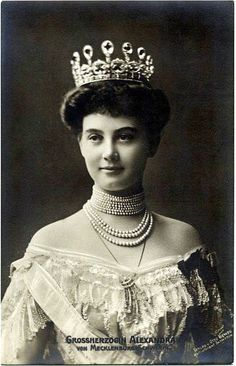 A diamond belle epoque tiara of 1903. Worn here by Alexandra of Cumberland, niece of Queen Alexandra, who went on to marry into the Grand Ducal family of Mecklenburg-Schwerin. Featuring nine, upright, pear-shaped diamonds, with foliate spacers, set on an open-work band of diamonds.